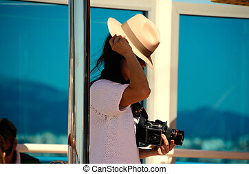 woman with hat and old camera - woman in white with hat and...