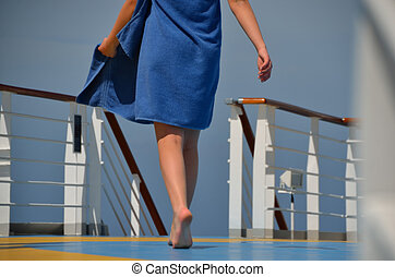 woman with towel on cruise ship - young woman with blue...