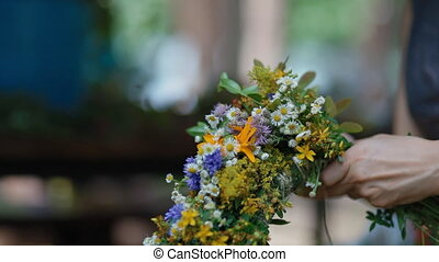 Making wreath from motley grass - Woman makes beautiful...