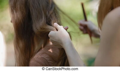 Hairdresser combing hair before making hairdress