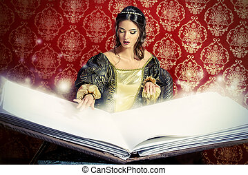 book of spells - Fairy beautiful witch reads magic book of...