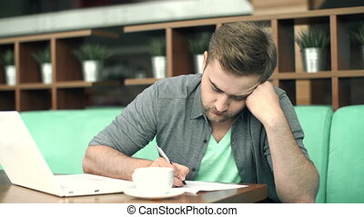 Brain Work - Close up of young guy doing his task with...
