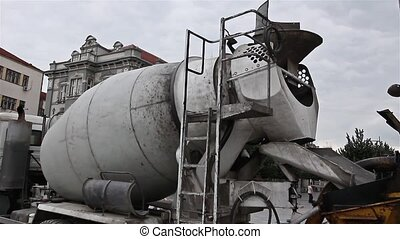 Cement mixer truck. - Mixer truck is preparing to unload the...