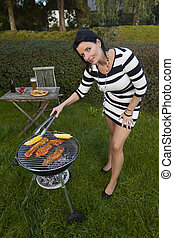 woman at a bbq in the garden