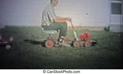 NEW HAVEN, CONN USA - 1957: Dad on lawnmower - Unique...