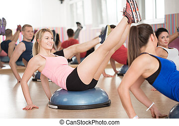 Bosu training in fitness club - View of bosu training in...