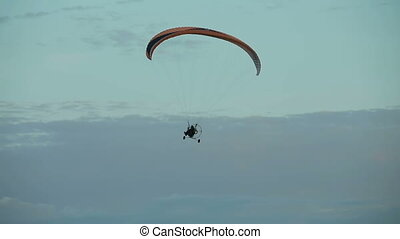 Paramotor flying in the air - Paraglider flying in the sky...