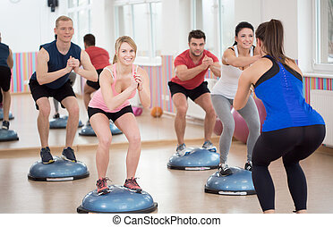 Group of people during balance training, horizontal