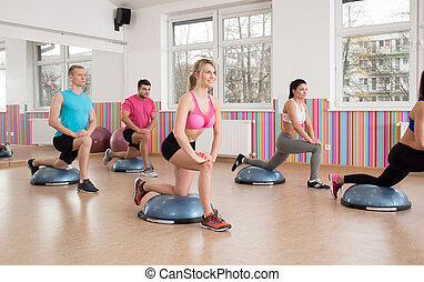 Training with bosu ball - Horizontal view of training with...
