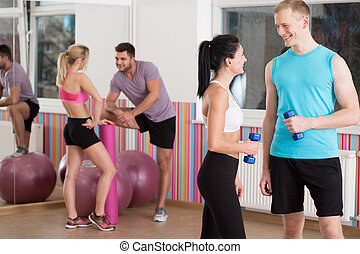 Talking before fitness training - Horizontal view of talking...