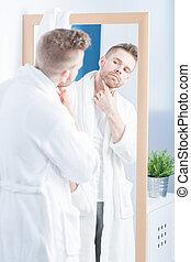 Admiring himself in mirror