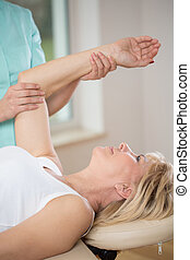 Woman at physiotherapist - Elderly woman exercising at...