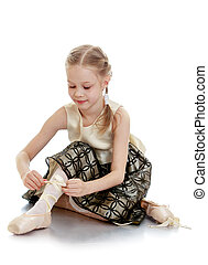 Beautiful blonde ballerina girl in a beautiful long dress...