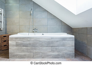 Bathtub with wooden housing - Vertical view of bathtub with...