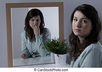 Woman with emotional problem - Worried and scared young...