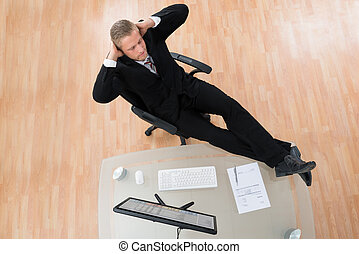 Businessman Relaxing On Chair