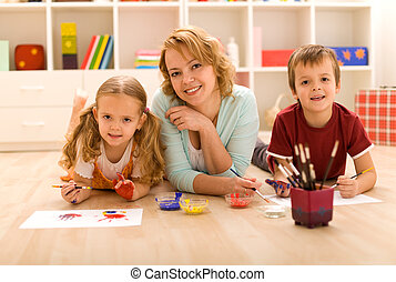 Woman and kids doing heavy artwork
