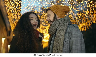 Lights of the City - Close up of sweet couple standing in...