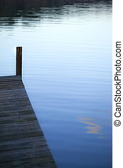 Pontoon - Wooden pontoon on a lake at dusk