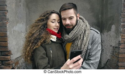 Urban Romance - Close up of young couple taking a selfie in...