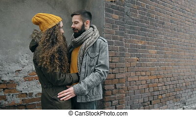 Romantic City - Close up of young hipster couple hugging in...