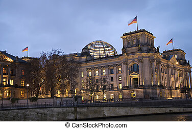 berlin reichstag building with river spree at night