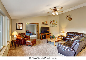 Cozy living room with brown leather couch - Cozy living room...