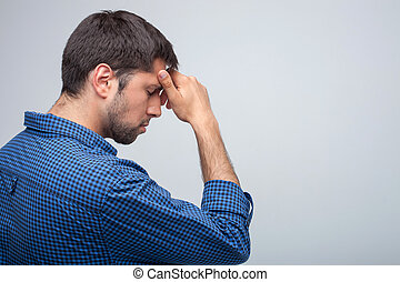 Attractive young man feels pain in his head - Handsome guy...