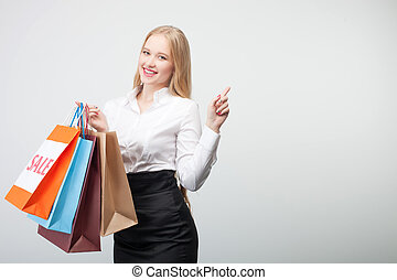 Cheerful young girl is doing shopping happily - Attractive...