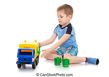 small blond boy in a blue t-shirt and shorts