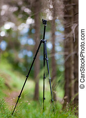 An open tripod, without mounted camera, in a summer mountain...