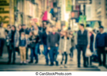 Pedestrian Blur - Defocused vintage toned pedestrians at...
