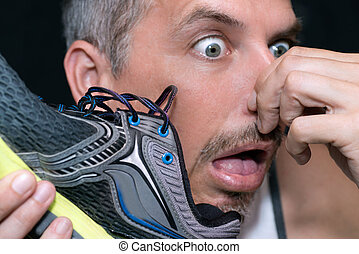Man Gags After Smelling Shoe - Close-up of a man gagging...