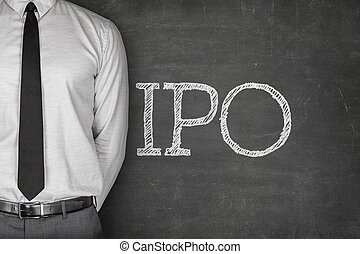 IPO or Initial public offering text on blackboard with...