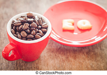 EQ alphabet biscuit with red coffee cup, stock photo