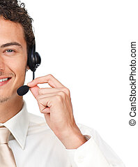 Close-up of a young businessman using headset