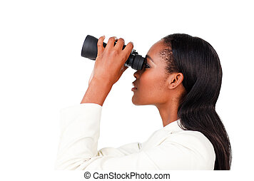 Charismatic businesswoman looking to the future through binoculars against a white background