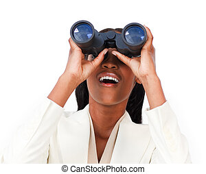 Surprised businesswoman looking through binoculars against a...