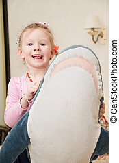 Girl Playing with Plush Toy - Little girl is playing with...