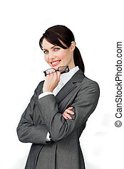 Smiling confident businesswoman holding glasses against a...