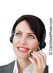 Self-assured businesswoman with headset on against a white...