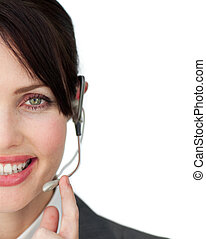 Close-up of an attractive customer service agent against a...