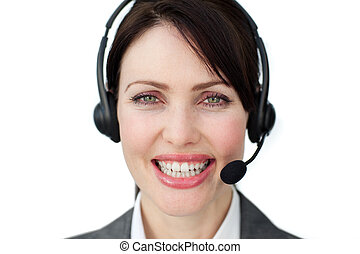 Bright female executive with headset on isolated on a white...