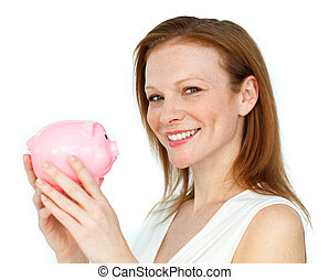 Self-assured businesswoman holding a piggybank