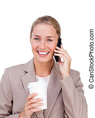 Positive businesswoman on phone while drinking a coffee