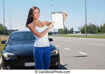 Attractive young girl is buying a new transport