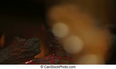 Glasses of Champaign Near Fireplace - First in focus the...