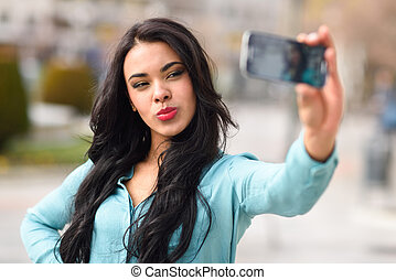 Beautiful young woman selfie in the park - Portrait of a...