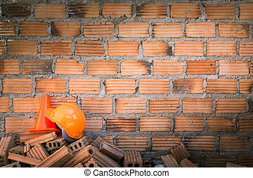 hard hat safety helmet in construction site with brick wall