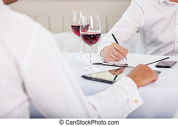Successful business partners have a meeting in restaurant -...